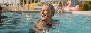 lady-swimming-smiling-900x350